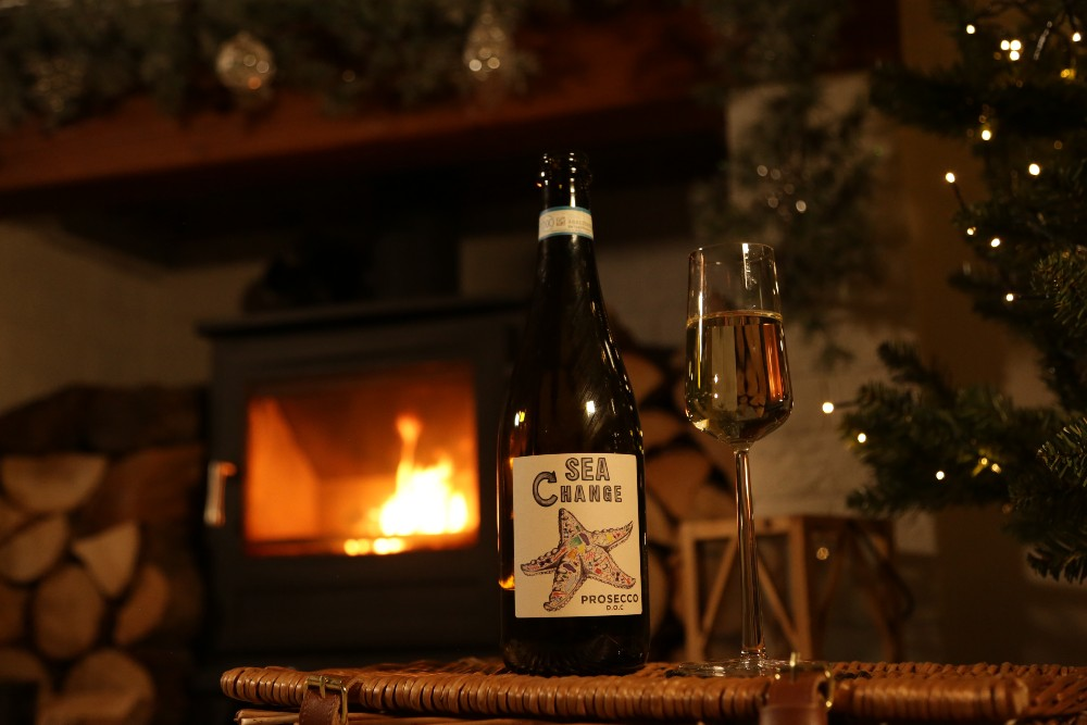 Enjoy a prosecco by the fire