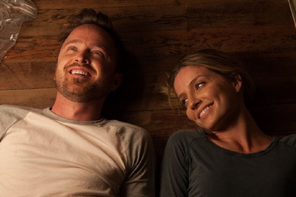 Annabel Wallis and Aaron Paul star