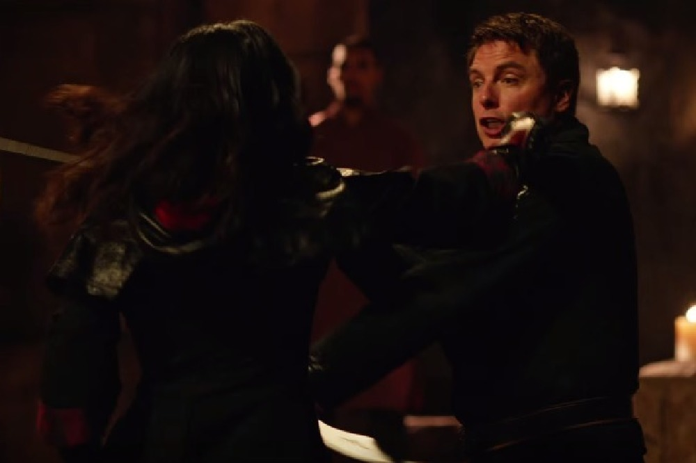 Nyssa fights Malcolm in season 4 / Credit: The CW