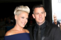 Pink and Carey Hart (Credit: Famous)