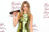 Cara Delevingne with her model of the year award