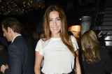 Lisa Snowdon looks chic in her leather skirt