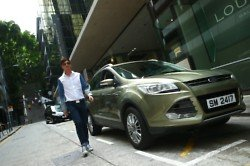 Dorian Ho arrives at the EcoChic press conference in a Ford Kuga