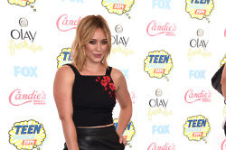 Hilary Duff looks chic in her leather pencil skirt