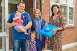 Television presenter Kirstie Allsopp (right)  presents Liza and Chris Freudmann and their children Megan, aged 3 and Lucas, aged 6 months from Ruislip