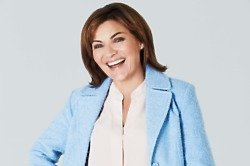 Lorraine Kelly models her first collection for JD Williams AW14; boucle coat £85, white slim leg jean £30, blouse £35