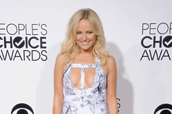Malin Akerman put on some front in her revealing dress