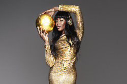 Naomi is wearing 24c Gold Beats Pro Headphones