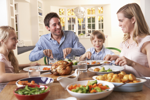Family dinners are a good time to teach the kids to eat healthy