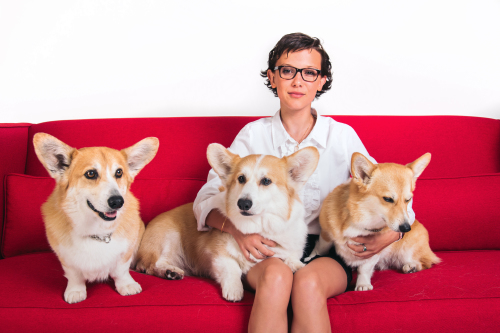 Millie Bobby Brown enjoys The Crown with the show's corgis!