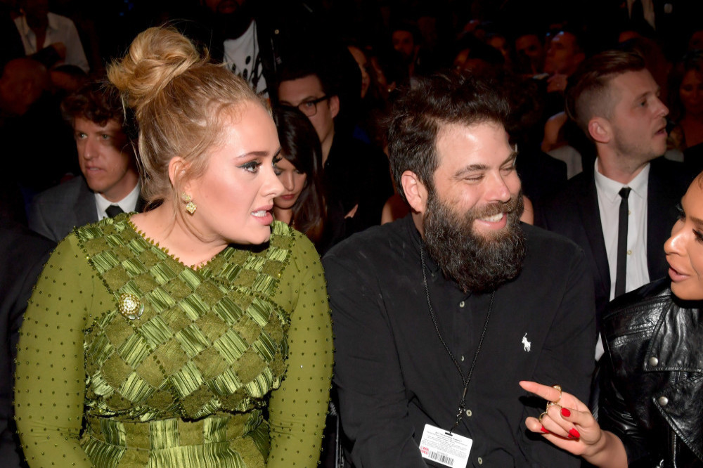Adele reaches divorce settlement with ex Simon Konecki two years after split