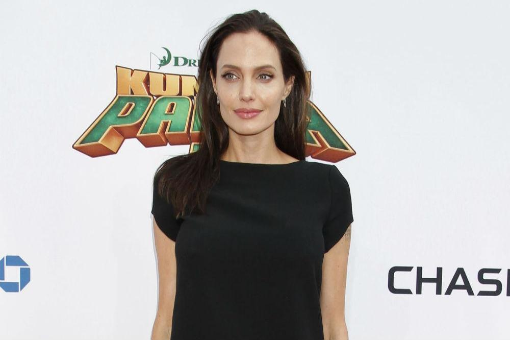 Angelina Jolie stuns in Givenchy alongside her brood at 'The Breadwinner' premiere
