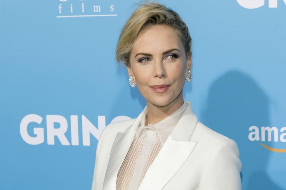 Charlize Theron 'struggled mentally' through the adoption process