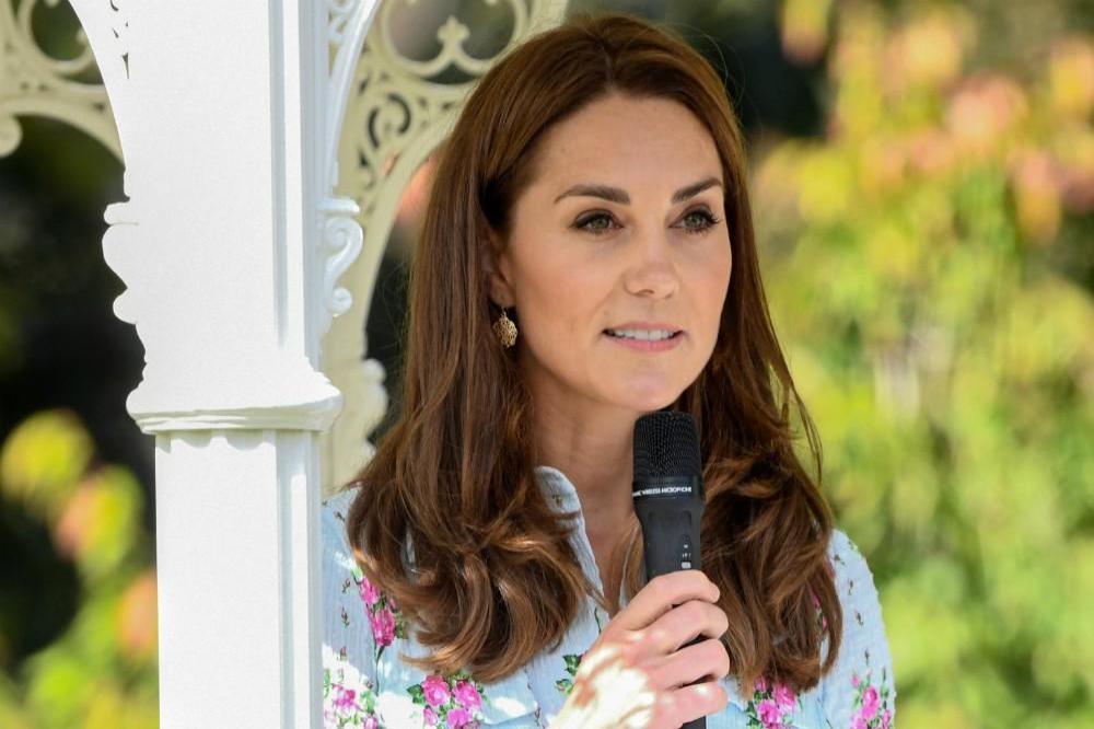 Kate Middleton gardens in $2,255 Emilia Wickstead dress