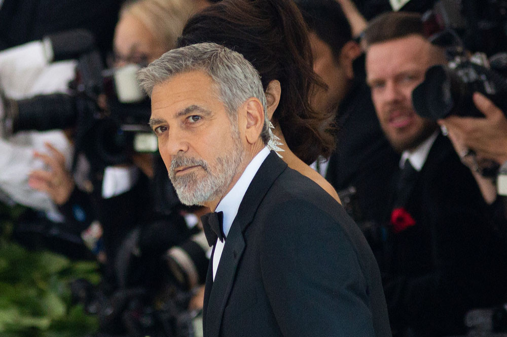 George Clooney confesses that he cuts his hair himself