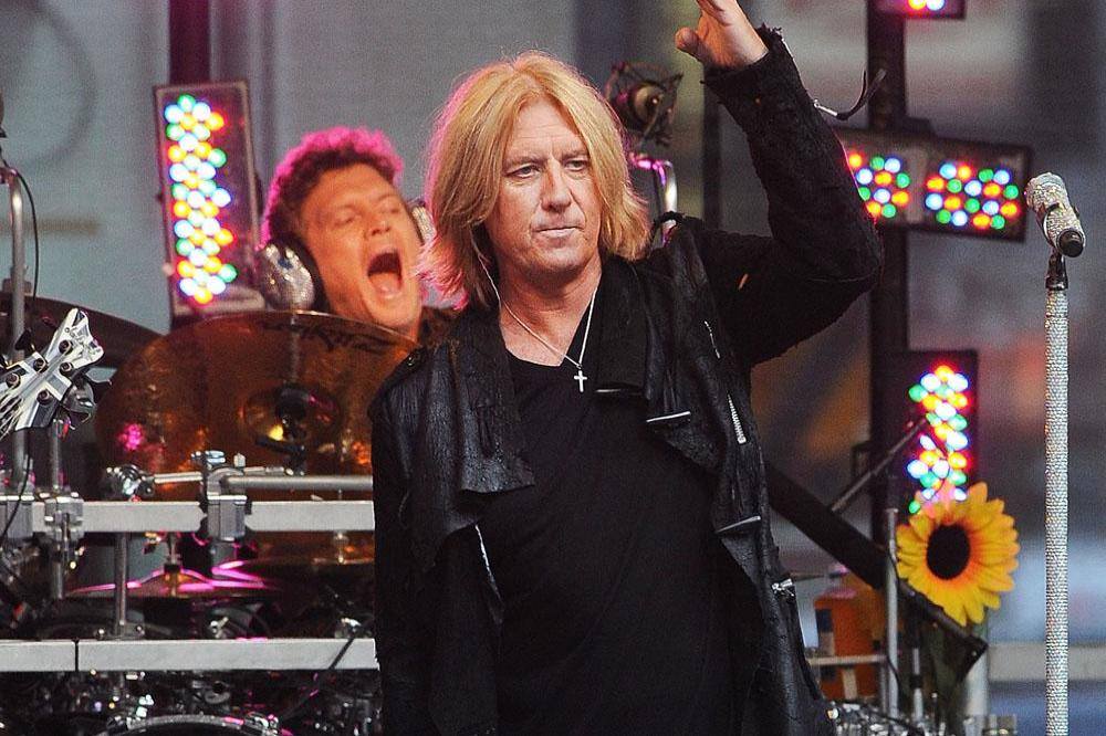 7b6e37638 Joe Elliott wouldn't have replaced Brian Johnson with Axl Rose