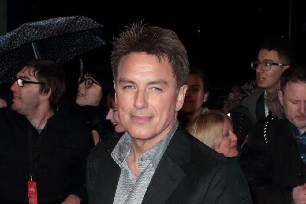 John Barrowman has 'big needles' put into neck after injury