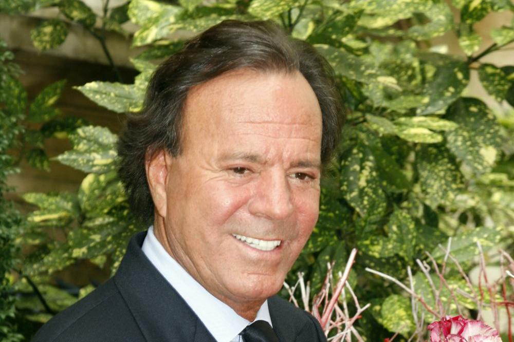 Spain court rules 43-year-old man is son of Julio Iglesias