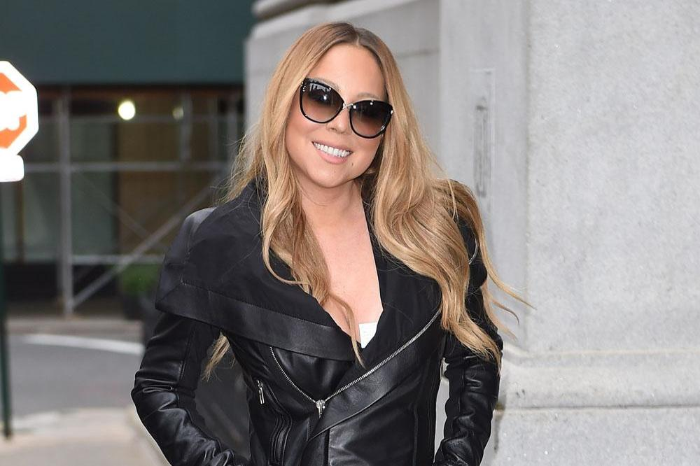 Mariah Carey sets wedding gown on fire
