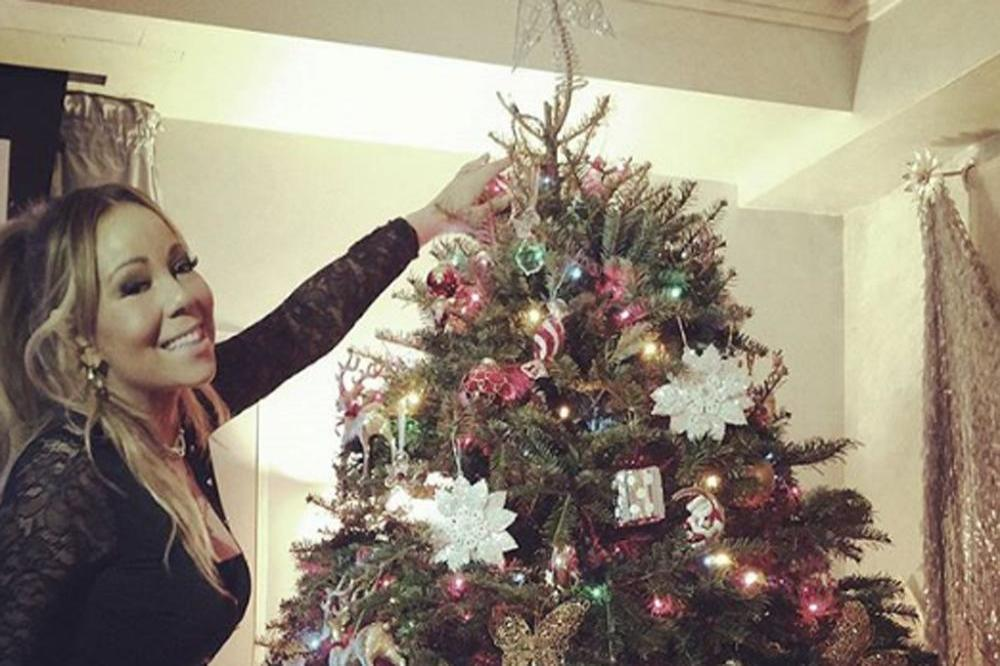 Mariah Carey with her Christmas tree