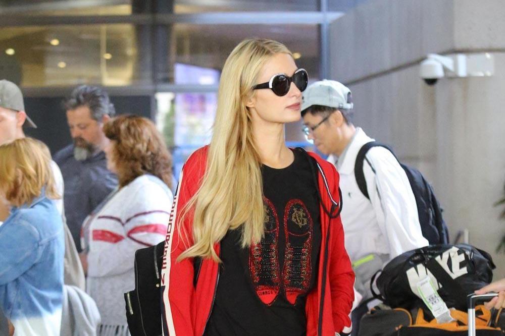 Paris Hilton Admits She STOLE Iconic Catchphrase 'That's Hot'!