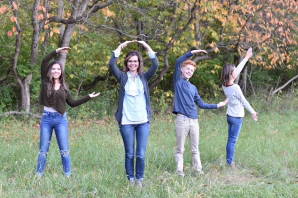 Children spell rude word instead of love in family picture