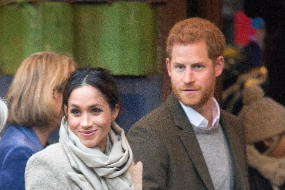 Prince Harry and Meghan Markle in Brixton (c) Zak Hussein
