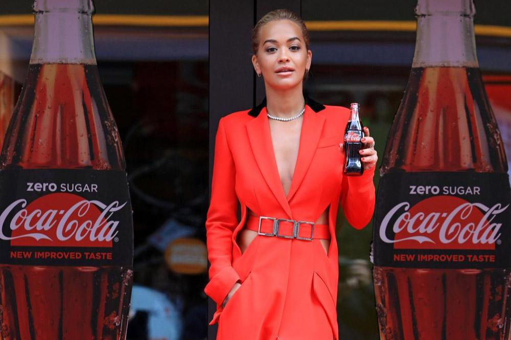 rita ora wows in red at coca cola launch