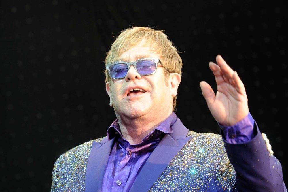 Elton john writing a song