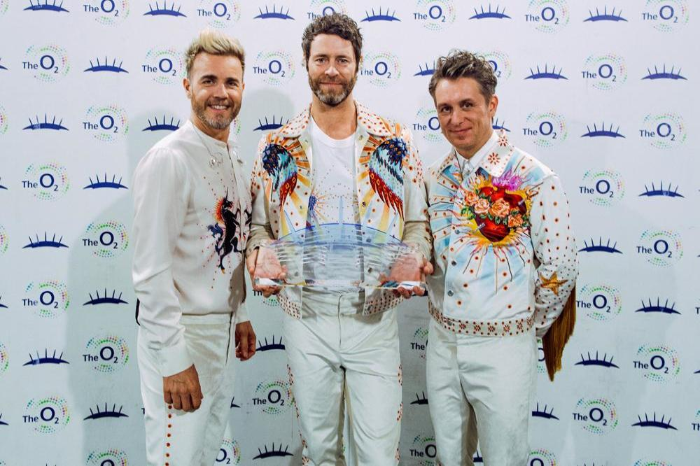 Take That receive award from The O2