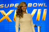 Beyonce works her cream long-sleeved mini dress