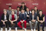 One Direction pose with waxworks