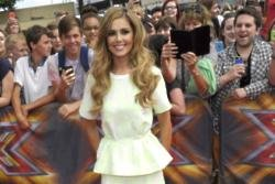 Cheryl Tweedy took to the catwalk for the first time since Baby Bear