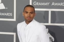 Chris Brown and Rihanna Snuggle Up at Grammy's