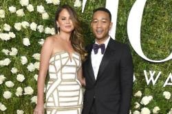 Chrissy Teigen sends John Legend 'sexy photographs'