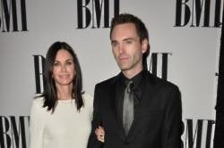 Courteney Cox and Johnny McDaid can't decide where to live