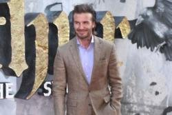 David Beckham not involved in wife's work