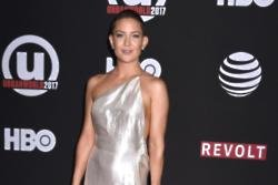 Kate Hudson is reluctant to leave her family for work