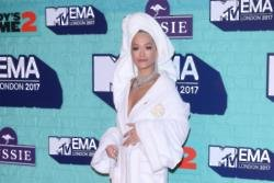 Rita Ora attends MTV EMAs red carpet in bathrobe