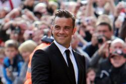 Robbie Williams Buffs Up To Promote Clothing Line