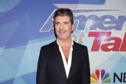 Simon Cowell gives relationship advice to his three-year-old son