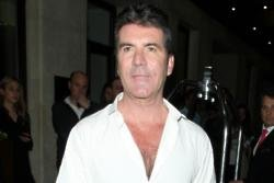 Simon Cowell 'doing better' after fall