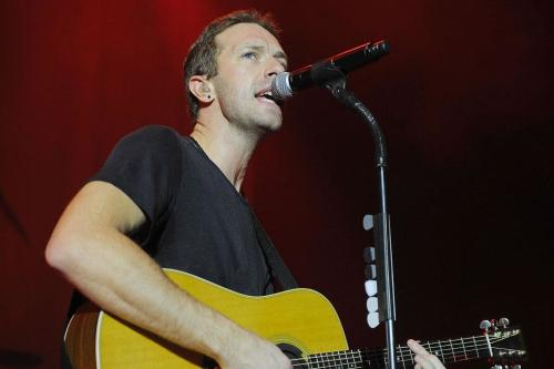 Chris Martin 'cosied up to Katy Perry at Glastonbury'