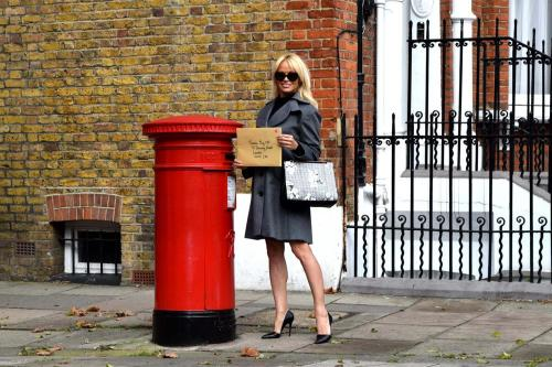Pamela Anderson posting her letter to Theresa May