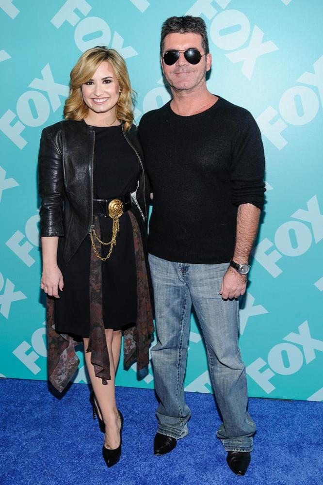 simon cowell and demi lovato relationship with her dad