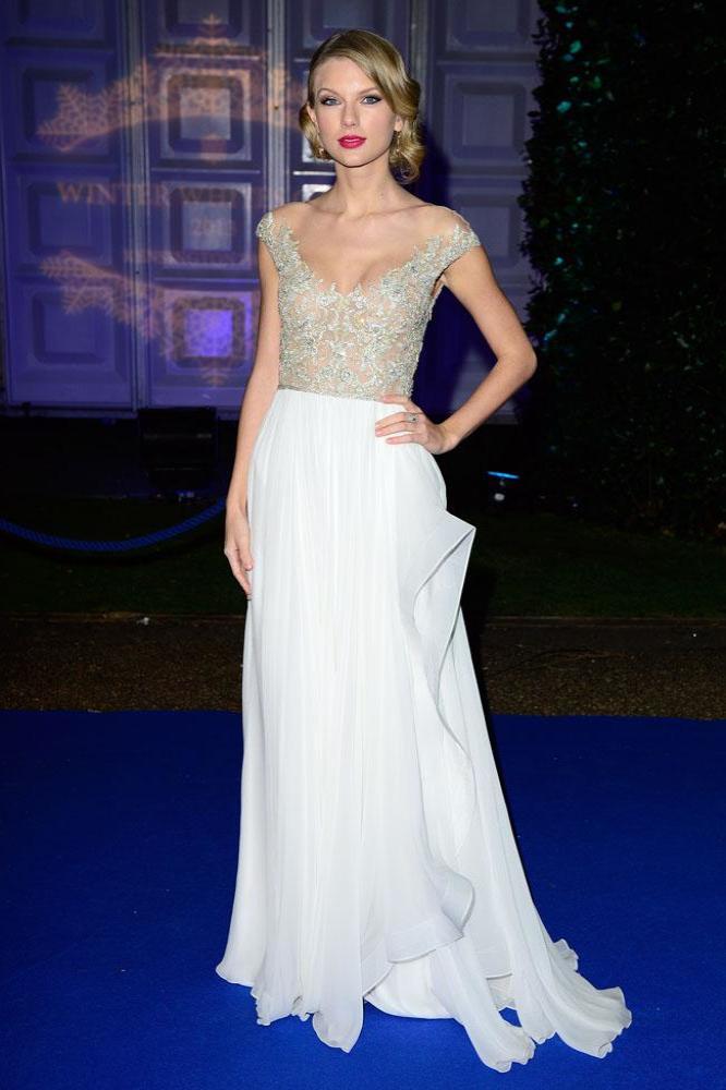 Taylor Swift wears winter white Reem Acra gown