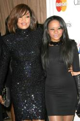 Bobbi Kristina with her mother Whitney Houston