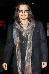 Johnny Depp arriving at David Furnish's birthday party