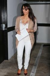 Kim Kardashian covers the baby bump in a loose camisole top