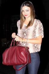 Miranda Kerr carries her on-trend berry handbag